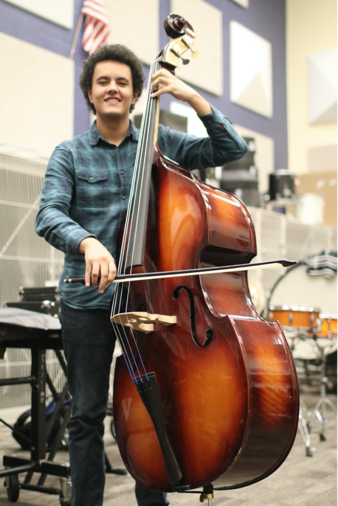 Student playing bass instrument